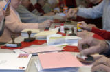 (LOVELAND, Colo., February 2, 2005) One of three long tables saw fast action from hands to stamps...