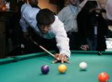 Miami Heat center Alonzo Mourning lines up a shot during his 8-Ball Tournament at the Wynkoop...