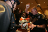 (02/ 03/ 2005 Aurora, Colorado) Shareef Aleem, Aurora, pushes CU police officer Greg Barthlome,...