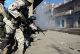 NYT6 - (NYT6) BAGHDAD, Iraq -- Feb. 18, 2005 -- IRAQ-5 -- U.S. soldiers, left, with the 1st...