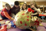 (Denver, Colo.- Feb. 4, 2005) From left: Art teacher Angela Hottinger helps students Christian...