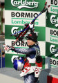 (BORMIO, Italy - Shot 2/5/2005) U.S. skiier Daron Rahlves points and raises his arms in victory as...