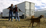 (DENVER Colo., February 20, 2005) Alan Bevill and  Bill Scribner watch  Reilly (Bill's dog) and...