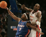 Denver 02/20/2005 ----  East's Jermaine O'Neal, #7, left, collides with West's Kevin Garnett under...