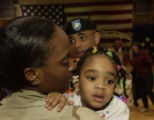 (FORT CARSON, Colo., February 8, 2005) Sgt. Dede Reed just returned, holds her daughter, Whitney...