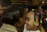 (FORT CARSON, Colo., February 8, 2005) Sgt. Dede Reed greets her excited daughter Whitney...