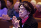 (DENVER, Colo., February 09, 2005)  Edda Alan, from Denver prays during services on Ash Wednesday...