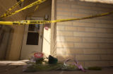 (DENVER, Colo., February 19, 2005) Flowers lie on the ground beneath police tape that covers the...