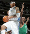 DXA104 - Denver Nuggets forward Kenyon Martin, left, pulls down a rebound in front of Boston...