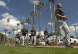 [(Tucson, AZ, Shot on: 2/23/05)] A group of Colorado Rockies pitchers run spints after practice...