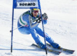 (BORMIO, Italy - Shot 2/10/2005) Swiss skiier Didier Defago (#8) tucks past a gate during the...