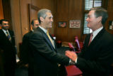 (Shot on 02/25/2005 in Denver) Colorado Gov. Bill Owens, right, greets Guatamalan Ambassador to...