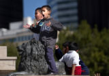 (Denver, Colo., July 20, 2004) Will Estevez, 17, left, holds onto his little brother, Rocky...
