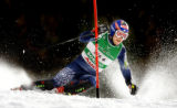 (BORMIO, Italy - Shot 2/13/2005) U.S. skiier Bode Miller carves past a gate during his slalom run...