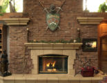 Artist Barry Rose made the terracotta work around the fireplace in the home of Herb and Betty...