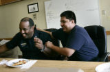 At Denver Fire Station 10, Capt Kevin Duncan jokes with Eng. Rod Rodriquez during their lunch...