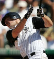 DXF110 - Colorado Rockies' Garrett Atkins follows the flight of his solo home run on a pitch from...