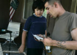 SGT Juan Polino, cq, a member of Fort Carson's 3rd ACR, shows his ten year old brother Ramon , cq,...