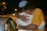 SGT Juan Polino, cq, a member of Fort Carson's 3rd ACR, hugs his cousin Hugo Moreno, cq, who he...