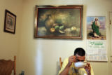 SGT Juan Polino, cq, a member of Fort Carson's 3rd ACR, enjoys a bowl of menudo in his parents' ...