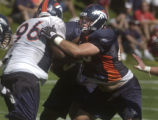 Denver Bronco #65 Cooper Carlisle (right) fights off #96 Dorsett Davis during a running play on...