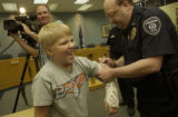 Ryan Sullivan, (cq), 12, was awarded an official Lafayette Police Citizen's Commendation. The...