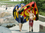 Denver, CO Au9. 8 2005 Brothers Graham (right) 9, and Julian Gilliatte, 14, haul their rafts to...