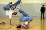 (DENVER, Colo., April 6, 2004) Josh Vigil grabs the foot of Richard Romero during B-Boy dance...