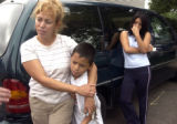 Aracely Nielsea stands with her son Ernesto and neice Astrid Diego after a natural gas explosion...