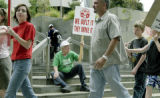 Denver, CO Aug. 12, 2005 Dave Childs (seated) , a retired  state government worker, supports ...