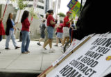 Denver, CO Aug. 12, 2005 Quest union employees picket  outside the Quest building at 1005 17th st....