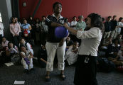 Tera Jones, 15, center, a sophmore at Denver School of Science and Technology, picks a student's...