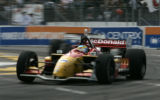 Sabastien Bourdais turns through turn one as he holds the lead during the  Champ Car race at the...