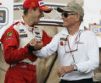 JPM0307 - Newman/Haas Racing driver Sebastien Bourdais, of France, left, shakes hands with this...