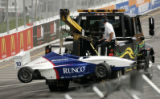 A tow truck takes away a wrecked car after the BMW Race at the Grand prix of Denver in Denver...