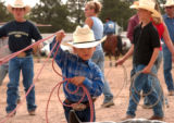 CHEYENNE, Wyoming, July 22,, 2004)Whit Kitchens,4, Mullin, Texas, takes practice time seriously....