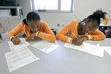 Bruce Randolph Middle School eighth graders Joyce Manard (cq, left), 13, and her cousin Brittany...