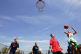 Bruce Randolph Middle School eighth graders play basketball during lunch on the first day of...