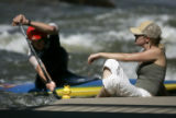 Amy Hochevar (cq), right, of Denver relaxes by the water as C-1 (single person decked canoe, much...