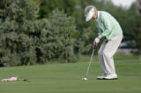 Wilma Erickson, (cq) 81, of Denver, putts a ball on the golf course during a game of golf at...