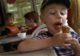 (7/19/2004, Denver, CO)   Benjamin Logan, 3, takes a look at the last bite of his chocolate ice...