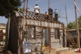 Habitat for Humanity volunteers from six countries are building houses in a fishing village in...