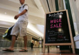 A clearance sale sign beckons shoppers at the Cherry Creek Mall in Denver, on Tuesday afternoon,...