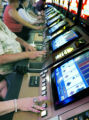 Denver, CO Aug. 17, 2005 Gamblers play video poker in Blackhawk's Isle of Capri Casino. The latest...