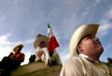 (DENVER COLORADO - May 2, 2004 ) Jorge Gonzalez of Denver (right) sits in the amphitheater in...