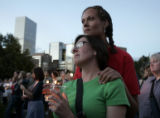 Laura Baxendale, cq, left, and Stacy Jackson, cq, both of Denver, gather in Civic Center Park for...