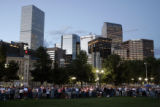 Hundreds gather in Civic Center Park for a vigil in support of Cindy Sheehan, whose son was killed...