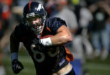 Denver Broncos Jeb Putzier turns up-field after making a reception during Broncos camp at Dove...