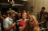 Trevor Davis (cq),19, of Grand Junction, Colo.,left in hat, Laura Anderson (cq) (middle in...