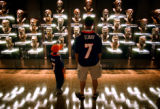 (CANTON, Ohio., SHOT 8/6/2004) Kenny Medina (right) of Westminster looks over some of the busts of...